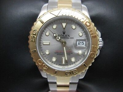 ROLEX LADIES 29MM YACHTMASTER 18K GOLD AND STEEL WATCH WITH SILVER DIAL