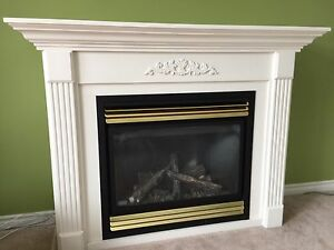 Gas Fireplace with mantle and surround.
