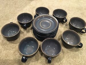 Set of 8 tea cups and saucers