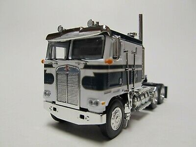 DCP 1/64 SCALE KENWORTH K-100 FLAT TOP, BLUE & WHITE, DUAL STACKS
