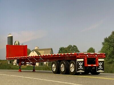 1/64 DCP RED 53' WILSON ROAD BRUTE TRI AXLE FLATBED TRAILER W/ BULKHEAD