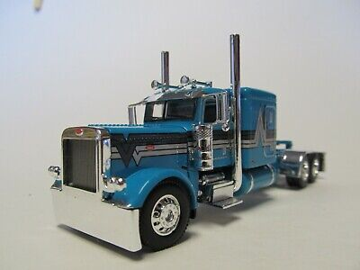 DCP FIRST GEAR 1/64 SCALE 389 PETERBILT FLAT TOP, TEAL WITH BLACK/ SILVER STRIPE