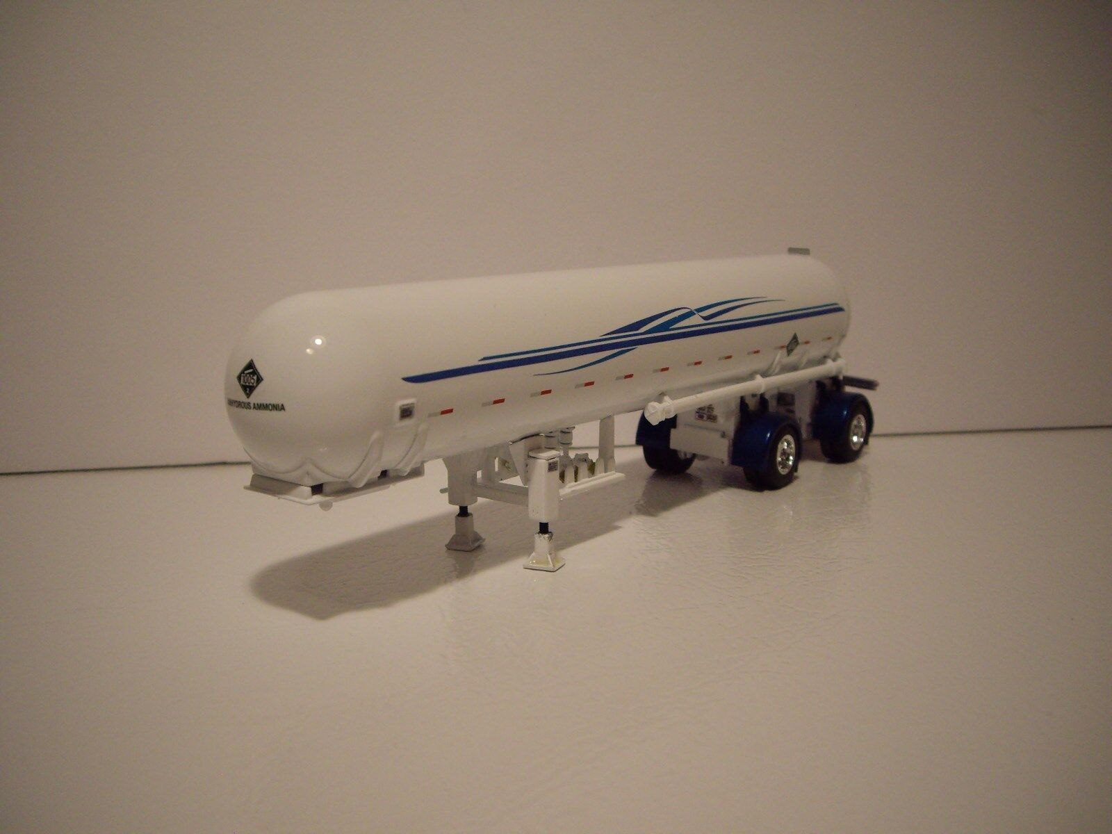 DCP FIRST GEAR 1/64 WHITE WITH BLUE GRAPHICS SPREAD AXLE ANHYDROUS TANKER