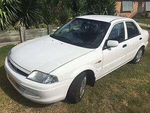 Ford laser (mazda323) with rego till 2018 cheap Argenton Lake Macquarie Area Preview
