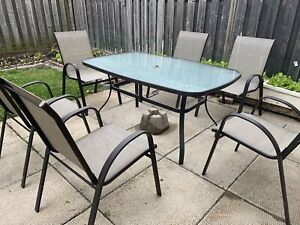 moving sale: patio table with 6 chairs
