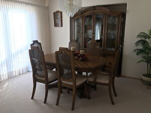Solid wood dining room table, 6 chairs, hutch and table leaf