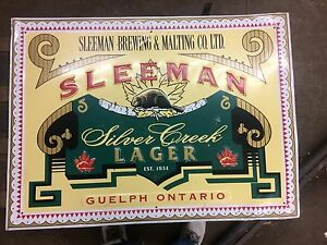 Sleeman silver creek lager. Tin signs. Embossed. X2.
