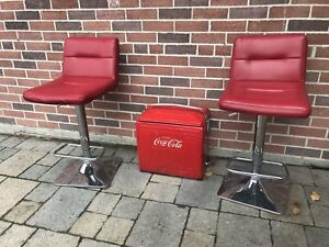 2 red bar chairs and 1956 Coke a cola cooler