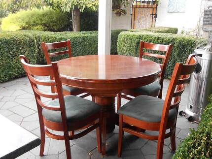 timber extendable pedestal dining table and chairs