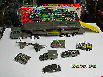 ARMY COMBAT CARRIER MILITARY N MINT IN BOX FRICTION WORKS HAS ALL VEHICLES 21