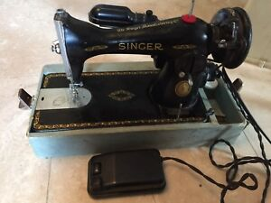Antique Singer Sewing Machine - 1949 with carrying case.