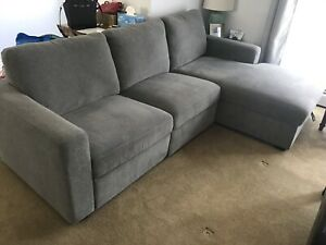 2-Piece Grey Reclining Sectional w/ Chaise & Storage