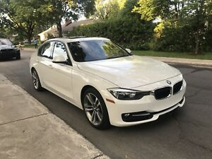 Good looking BMW ( white with red interior ) sport package