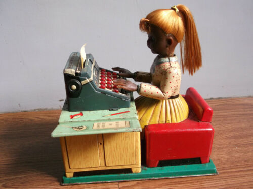 Rare vintage battery powered TYPIST doll tin toy made in Japan (Working order).