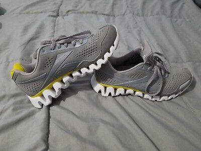 edd348dcf5e Reebok Women s Zig Flow Gray Yellow Running Shoe