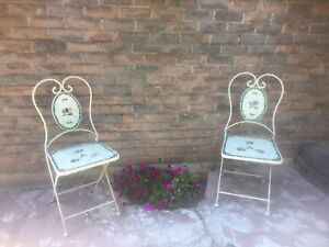 Mosaic tiled wrought iron bistro chairs