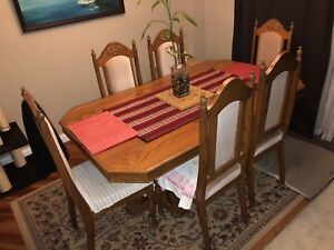 Extendable wood dining table and chairs