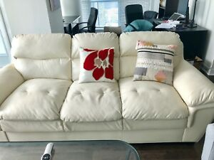 White leather sofa with 2 arm chairs and coffee table