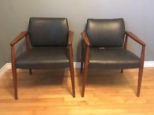 Pair of mid century modern Oak and leather tilt-back armchairs