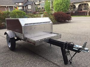 Motor cycle/utility trailer.
