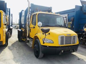Two 2009 freightliner m2's with ASL garbage packer low km/hours