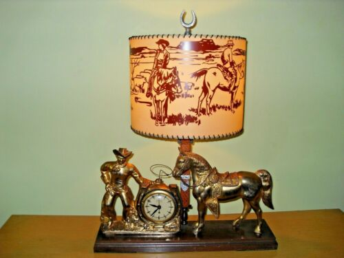 **VINTAGE  EXTREMELY  RARE  UNITED COWBOY HORSE AND LAMP CLOCK SEE DESCRIPTION**