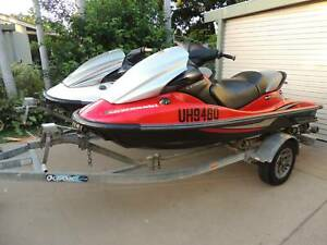 Kawasaki STX 15F Jetskis on dual trailer