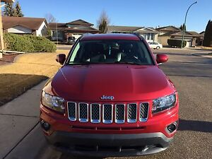 2014 Jeep Compass with 5,600km.