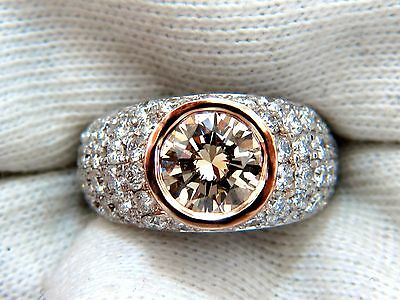 GIA Certified 3.08ct. Fancy light brown round cut diamond ring 14kt + 7