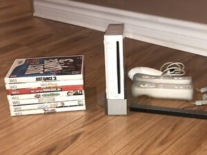 Wii with 7 games and 2 remotes!