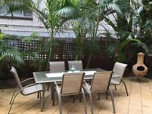 Outdoor glass dining table with 8 chairs Coogee Eastern Suburbs Preview