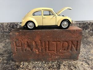 VW Beetle toy car with antique HAMILTON brick works combo.
