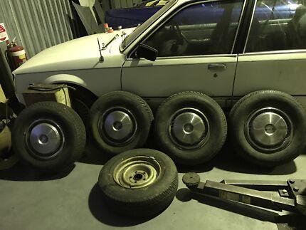 hq hj hz hx stock wheels great tread and hub caps  Morisset Lake Macquarie Area Preview