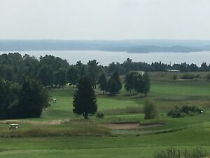 Resort Cottage Lifestyle on lake and champ. Golf course!