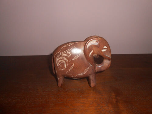Rock Carved Elephant Etched Fish
