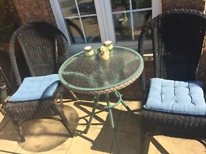 Glass table whicker chairs ! Patio furniture