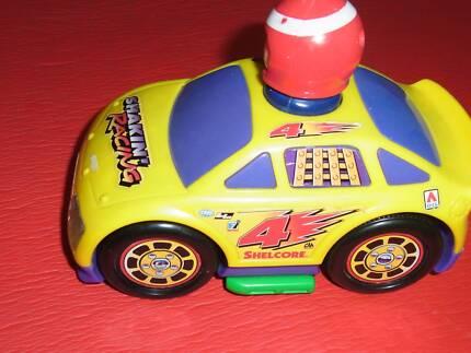 racing car that makes nioses when you press teh drivers head