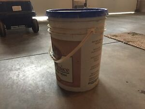 Half a pail of ice melter