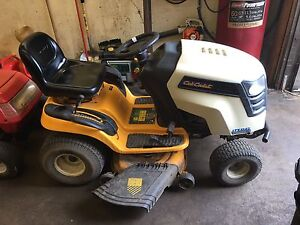 Two lawn mowers for sale today only , cub cadet and turf pro