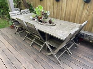 Teak outdoor extending table and chairs setting