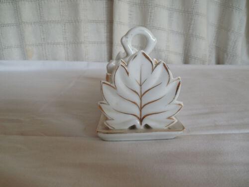 Vintage porcelain toast holder, rack leaf design