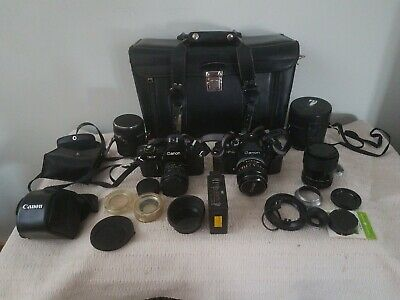 Canon F-1 New SLR, Canon EF SLR 35 mm cameras. Both near mint.