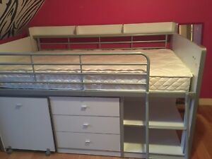 Loft bed with underneath storage and slide out desk.