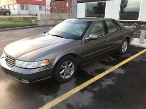 Two 1999 Cadillac sts