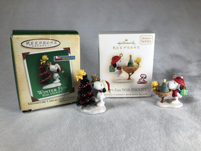 Lot Of 2 Hallmark Miniature Ornaments  Winter Fun with Snoopy  2004 & 2009