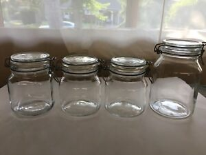 4 glass jars 3x 1 liter 1x 1.7 liters clamp down lids