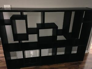 Wall sized shelving unit.