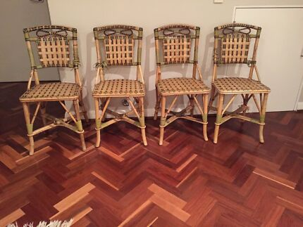 Four cane dining chairs