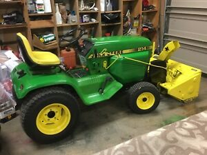 John Deere 214. Snow blower and deck