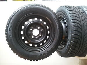 Two Snow Tires and Four Rims